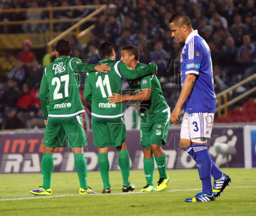 BOGOTA -COLOMBIA- 20 -11--2013. Carlos Lizarazo del Deportivo Cali celebra su gol  contra Millonarios    ,juego de los cuadrangulares finales de la Liga Postobon jugado en el estadio Nemesio Camacho El Campin   /  Carlos Lizarazo Deportivo Cali celebrates his goal against Millonarios game runs Postobon League finals played at the Estadio Nemesio Camacho El Campin.Photo: VizzorImage / Felipe Caicedol / Staff
