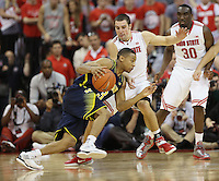 Ohio State Buckeyes guard Aaron Craft (4) applies tight defense against Michigan Wolverines guard Trey Burke (3) in second half action at Value City Arena on January 13, 2012.  (Chris Russell/The Columbus Dispatch)