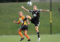 BOYDS, MARYLAND-JULY 07,2012:  Ashley Herndon (19) of DC United Women pulls the ball down in front of Lauren Hettinger (21) of Dayton Dutch Lions during a W League game at Maryland Soccerplex, in Boyds, Maryland. DC United women won 4-1.