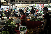 Shoppers buy organic fruits and vegetables at the organic farmers market in Sacedo Park in Makati, Manila in the Philippines. There is a surge in the demand for organic products to supply for people who can afford to pay extra.<br /> Photograph: Sanjit Das/Panos for Greenpeace