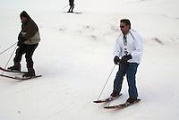 Switzerland. State of Ticino. Airolo. Peschün ski resort. Two men use old traditional skis. © 2005 Didier Ruef