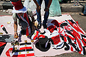 An Egyptian vendor lays out flags and hats he hopes to sell during a large July 8, 2011 protest in Tahrir Square in downtown Cairo, Egypt. Many of the protesters have vowed to stay in the square until the demands of the revolution are met, including an end to military trials of civilians, prosecution of police officers accused of murder or torture and open trials of former regime officials including ex-President Hosni Mubarak. (Photo by Scott Nelson/Der Spiegel)