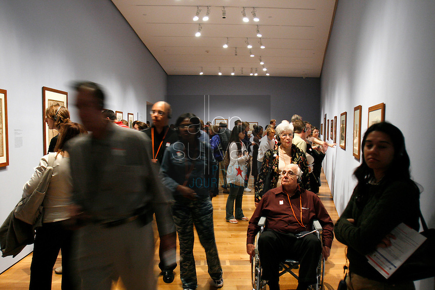 Patrons view a gallery during the pubic opening of Louvre Atlanta at the High Museum of Art. Over the next three years, the High Museum will feature hundreds of works of art from the Musée du Louvre in Paris.