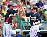 17 March 2009: Atlanta Braves' outfielder Josh Anderson gets a high-five from Jeff Francoeur after hitting a homer and crossing the plate during a Spring Training game against the New York Mets at Disney's Wide World of Sports in Orlando, Florida. The Braves defeated the Mets 5-1 in the Saint Patrick's Day Grapefruit League matchup. Mandatory Photo Credit: Ed Wolfstein Photo