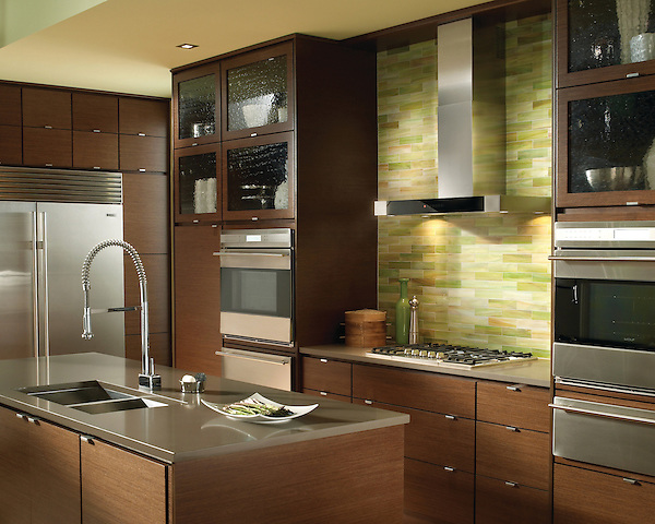 This custom kitchen features a Peridot jewel glass backsplash using 2&quot; x 8&quot; bricks from New Ravenna.<br /> <br /> For pricing, samples and design help, please click here:http: //www.newravenna.com/showrooms/