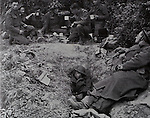 Mcc0061160 . Daily Telegraph<br /> <br /> Telegraph Magazine<br /> <br /> D Day Veterans<br /> Men of the 5th/7th Gordon Highlanders having a brew up in a slit trench near Touffreville June 17th 1944 .<br /> Galena is 2nd from right main group holding a mug in profile.<br /> <br /> Jim Glennie who served as a private in the 5th/7th Gordon Highlanders on D Day and was later taken prisoner during the battle for Caen.<br /> <br /> 26 March 2015