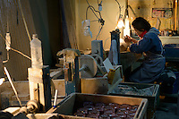 Edokiriko workshop, Shimizu Glass, Tokyo, Japan, January 14, 2015. Edokiriko is a style of cut glass that dates back to 1834 and is similar to British cut glass. It makes use coloured glass and highly-intricate Japanese motifs.