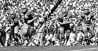 San Francisco 49er #42Doug Cunningham takes a han doff from QB John Brodie, with blockers Woody Peoples and Elmer Collett. (1969 photo/Ron Riesterer)