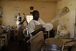 Zimbabwe, Howard Hospital. May 2010. Kitchen. Toziveri JAKATA, sadza maker; Peggy KHUMALO, bean cooker; Joyce MAKOSA, bread maker.