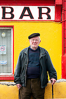Local man Star Bar, Inis Mór, Aaran Islands, County Galway, Ireland..The island of Inis Mór ( meaning the big island) is one of the most popular tourist destinations in Ireland. The islands inland landscape of uniquely blanketed rock surface are glazed with man made rock walls that meander and cross all directions as far as one can see. Well known internationally, it is steeped in history and resembles an outdoor museum with over 50 different monuments of Christian, pre Christian and Celtic mythological heritage. Picture James Horan