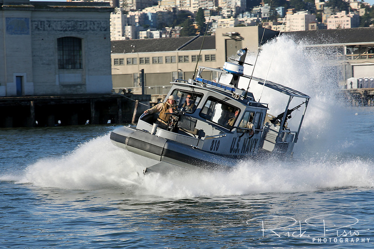 U.S. Navy Security forces patrol the San Francisco waterfront in ...