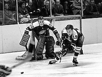 California Golden Seals goalie Gary Smith and #19 Bert Marshall..(1970 photo/Ron Riesterer)
