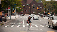 Bicyclists use a bike lane on Lafayette Avenue in the Fort Greene neighborhood of Brooklyn in New York on Saturday, August 25, 2012. (© Richard B. Levine)