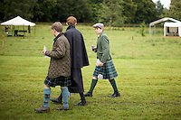 Young people wear kilts at the Inveraray Highland Games, held at Inveraray Castle in Argyll.