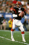 CLEVELAND, OH-UNDATED:  Boomer Esiason of the Cincinnati Bengals is pictured in action against the Cleveland Browns during an NFL game.  Esaison played in the NFL from 1984-1997.  (Photo by Ron Vesely)