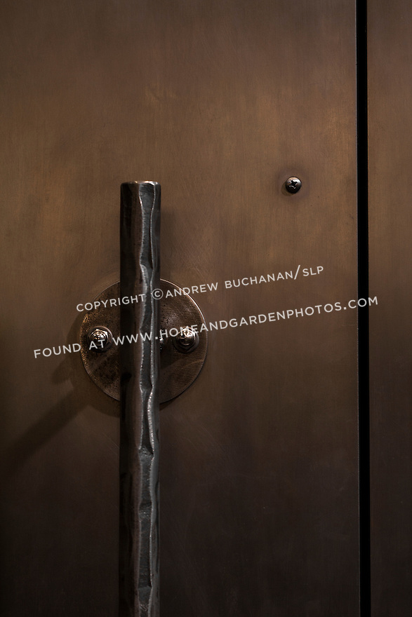Architectural detail of unique hammered metal door handles