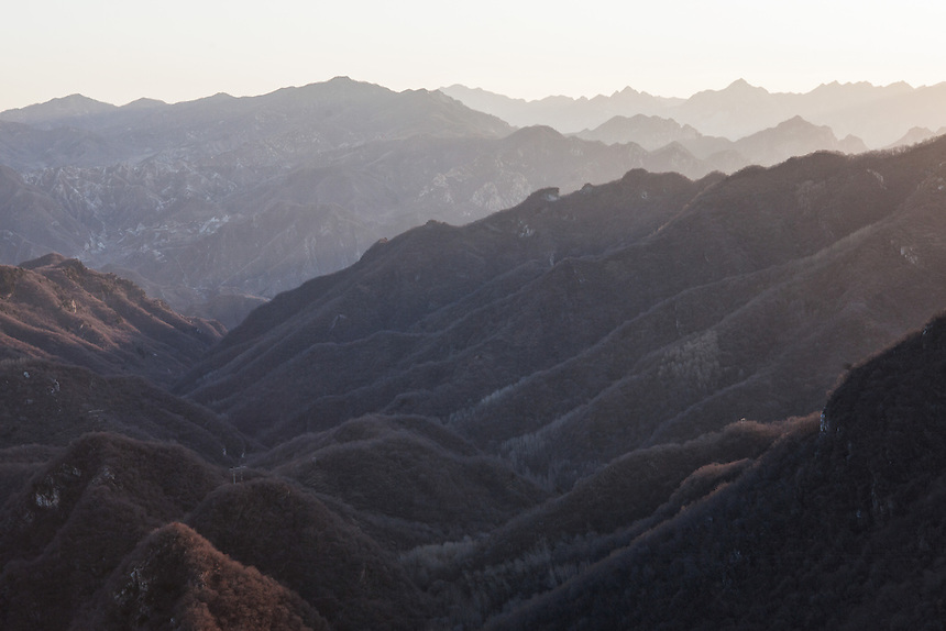 The early morning sun illuminate the steep and mountainous terrain around Jiankou Great Wall.