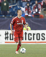 Toronto FC defender Steven Caldwell (13) looks to pass. In a Major League Soccer (MLS) match, the New England Revolution (blue) defeated Toronto FC (red), 2-0, at Gillette Stadium on May 25, 2013.