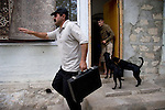 A scene outside Saro Sarian's home in Shushi, Nagorno-Karabakh, which he claimed in 1998 because it was abandoned.  He has been slowly renovating it since.