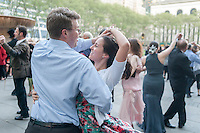 Hundreds channel their inner Fred Astaire and Ginger Rogers as they waltz the night away on the opening night of Dancing in Bryant Park, with a Waltz Ball, in New York on Wednesday, May 6, 2015. Everyone from beginners to amateur competitors participated in the weekly event, featuring a different style of dance each week. Live music and instruction complimented the popular event. (© Richard B. Levine)