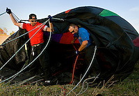 Two men work to fill a hot air balloon. Thousands of hot air balloon enthusiasts turn out each year for the annual Carolina BalloonFest, held each fall in Statesville, NC. Photos were taken at the October 2008 event.