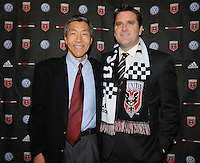 DC United Owner William Chang (left) with new Head Coach Curt Onalfo (right). During the presentation of the new Head Coach for the 2010 season at RFK Stadium, Tuesday January 5, 2010.
