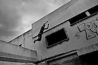A Colombian parkour athlete jumps from the wall during a free running training session of Plus Parkour team in Bogotá, Colombia, 22 February 2016. Parkour, originally developed in France during the late 1980s from military training, is a physical activity, focused on the art of movement and overcoming obstacles in a strictly urban environment. Practitioners of parkour employ running, climbing, jumping, rolling and other movements to pass through any urban area the most efficient way possible.