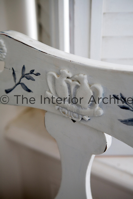 Detail of the back of a carved and hand-painted Swedish chair