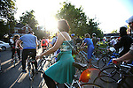 Participants prepare to start the Bike Prom event at the Living Arts and Science Center on North Martin Luther King Boulevard Saturday evening. Photo by Adam Wolffbrandt | Staff.