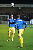 15.01.2013. Torquay, England. Torquay United defender Kevin Nicholson and Captain Lee Mansell in heading drill before the League Two game between Torquay United and Exeter City from Plainmoor.