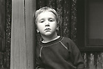 Young boy looking introspective. 1975