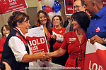 From left, Republican house candidates Lyn Gattis, District 9, and Lora Reinbold, District 26,  congratulate each other on their primary election leads Tuesday, Aug. 29, 2012 in Anchorage, Alaska.    (AP Photo / Michael Dinneen)