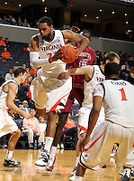 Nov 6, 2010; Charlottesville, VA, USA; Virginia Cavaliers f Mike Scott (23) grabs a rebound Saturday afternoon in exhibition action at John Paul Jones Arena. The Virginia men's basketball team recorded an 82-50 victory over Roanoke College.