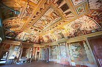 "Salon of the Fountain( Sala della Fontana ), the banquet hall of Cardinal Ipollito d""Este. The trompe-l'?il frescoes were carried out by 6 assistants of Girolamo Muziano (1532-1592) were inspired by the ""Solomonic"" winding columns of the Vatican Basilica to create a loggia decorated by festoons of fruit, flowers & vegetables with a landscape beyond. The rustic fountain at the end of the salon was built by fountain maker Curzio Maccarone and was completed in 1568. Villa d'Este, Tivoli, Italy. A UNESCO World Heritage Site."