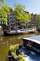 Traditional houseboats on Dutch canals, Prinsengracht,  in Amsterdam, Holland, The Netherlands