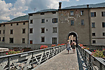 Bridge that crosses the River Adda to the old city gate, Porta Poschiavina, which links the old medieval town to the new town in Tirano, Italy.