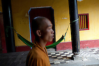 Buddhist monk Minh Thien, 29, prepares the pagoda for prayer time at the Giac Vien Pagoda in District 11 in Ho Chi Minh City, Vietnam. Photo taken Monday, May 3, 2010...Kevin German / LUCEO