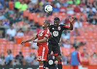 Brandon McDonald (4) of D.C. United head the ball against Jeremy Hall (25) of Toronto FC. Toronto FC defeated D.C. United 2-1, at RFK Stadium, Saturday June 15 , 2013.