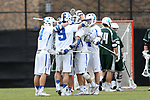 DURHAM, NC - MARCH 11: Duke's Reilly Walsh (right) is mobbed by Sean Lowrie (9), Mitch Russell (4), and other teammates after his goal had given Duke a 6-3 lead. The Duke University Blue Devils hosted the Loyola University Maryland Greyhounds on March 11, 2017, at Koskinen Stadium in Durham, NC in a Division I College Men's Lacrosse match. Duke won the game 15-7.