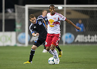 March 10th, 2013: Roy Miller controls the ball away from Sam Garza during a game at Buck Shaw Stadium, Santa Clara, Ca.   Earthquakes defeated Red Bulls 2-1