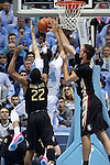 24 January 2015: Florida State's Boris Bojnovsky (right) blocks a shot by North Carolina's Justin Jackson (44) as Xavier Rathan-Mayes (CAN) (22) trails the play. The University of North Carolina Tar Heels played the Florida State University Seminoles in an NCAA Division I Men's basketball game at the Dean E. Smith Center in Chapel Hill, North Carolina. UNC won the game 78-74.