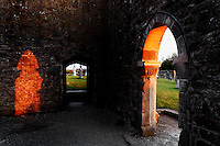 Low angle view through the arches of Clonmacnoise Cathedral, 10th century, Clonmacnoise, County Offaly, Ireland, at sunset. Clonmacnoise was founded by St Ciaran, with the help of Diarmait Ui Cerbaill, Ireland's first Christian King. Picture by Manuel Cohen