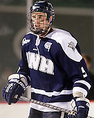 Eric Knodel (UNH - 5) - The University of Maine Black Bears defeated the University of New Hampshire Wildcats 5-4 in overtime on Saturday, January 7, 2012, at Fenway Park in Boston, Massachusetts.