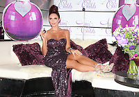 Amy Childs launches her debut fragrance - 'Amy Childs' with a photocall at Aura, St James, London, England..August 15th 2012.full length purple strapless dress sequins sequined sitting hair up silver sandals shoes slit split.CAP/ROS.©Steve Ross/Capital Pictures.