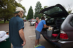 Left to right, Cobi Powell, Louise Powell, and Craig Powell unload their car on South Green during Go Green Move-In on Friday, August 19, 2016. © Ohio University / Photo by Kaitlin Owens