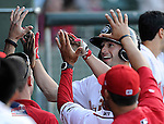 Right fielder Bo Greenwell (31) of the Greenville Drive is greeted in the dugout after hitting a leadoff home run in a game against the Asheville Tourists on Wednesday, April 23, 2014, at Fluor Field at the West End in Greenville, South Carolina. (Tom Priddy/Four Seam Images)