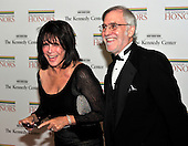 Michelle Lee and Fred Rappaport share a laugh as they arrive for the formal Artist's Dinner honoring the recipients of the 2011 Kennedy Center Honors hosted by United States Secretary of State Hillary Rodham Clinton at the U.S. Department of State in Washington, D.C. on Saturday, December 3, 2011. The 2011 honorees are actress Meryl Streep, singer Neil Diamond, actress Barbara Cook, musician Yo-Yo Ma, and musician Sonny Rollins..Credit: Ron Sachs / CNP