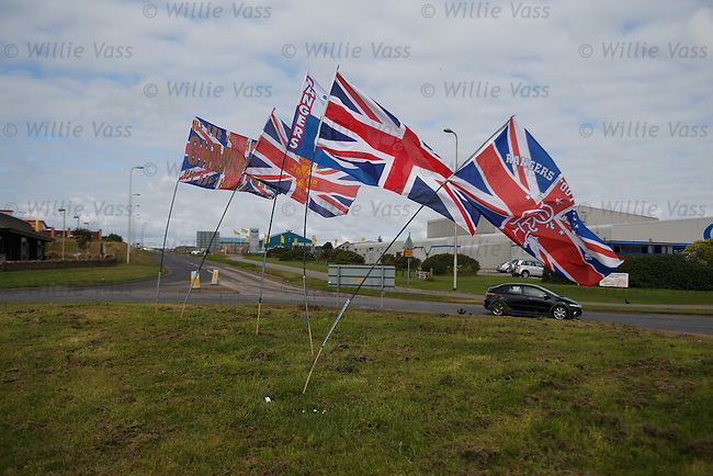 Welcome to Peterhead... Rangers flags adorning the roundabout on entrance to the blue toon