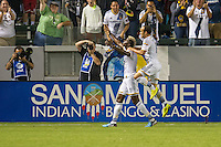 CARSON, CA - August 8, 2014: LA Galaxy players Gyasi Zardes (11) and Landon Donovan (10) celebrate Zardes' goal during the LA Galaxy vs San Jose Earthquakes match at the StubHub Center in Carson, California. Final score, LA Galaxy 2, San Jose Earthquakes 2.