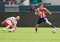Chivas USA midfielder Sacha Kljestan (16) moves past NY Red Bulls midfielder Joel Lindpere (20). Chivas USA defeated the Red Bulls of New York 2-0 at Home Depot Center stadium in Carson, California April 10, 2010.  .